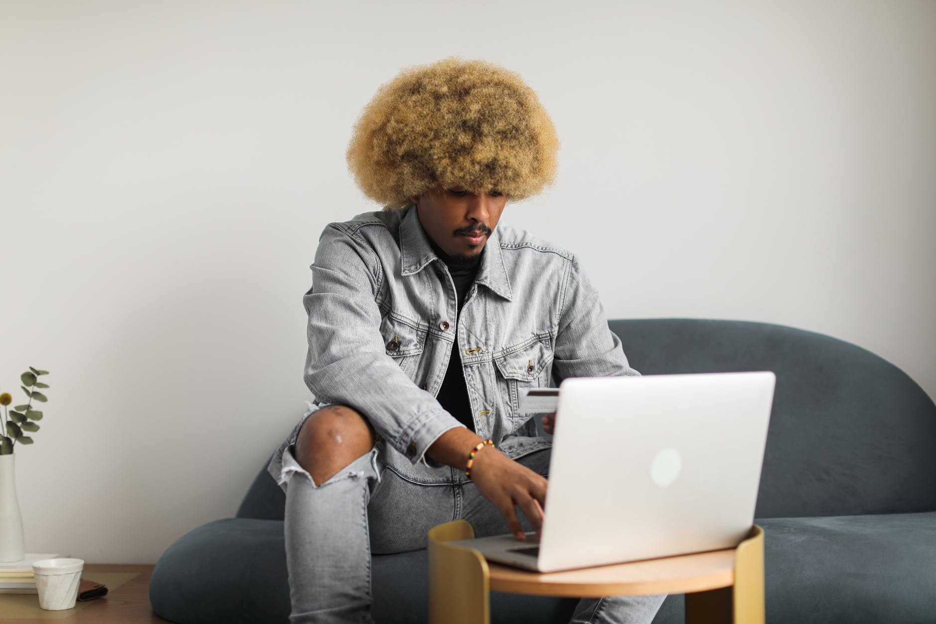man using laptop and bank card for online payment